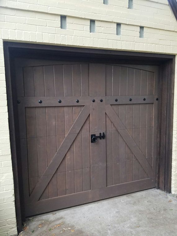 These are real wooden garage doors made by hand out of solid Cedar. We take a lot of pride in what we do and love making creations of Art. You can email, call or text me. My cell is 817-987-8343 Solid Cedar Doors 1. 7x16 2875 2. 8x7= 1375 3. 9x7 =1525 4. 10x7 =1675 5. 8x8 =1525