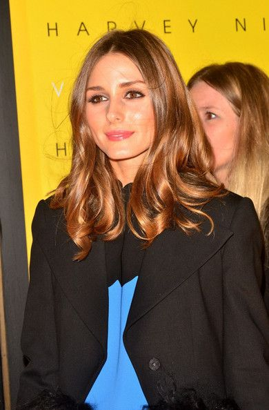 Olivia Palermo Photos Photos - Olivia Palermo poses for photographers at the launch of new fashion line 'Victoria' at Harvey Nichols in London.. - Victoria Beckham Launches Her Line at Harvey Nichols in London