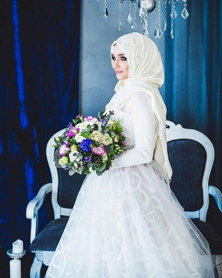 Stunning photo of the gorgeous winter queen @golovkova.s from Russia  Photographer: @gorelikova  Dress: @brides_dress_tomsk  MUA: @katyushamurka  Bouquet: @larisa.b  . . . #muslimwedding #muslimweddings #muslimweddingideas #islamicwedding #nikah #nikkah #nikaah  #hijab #hijabfashion #hijabbride #hijabibride #hijabibrides #hijabbrides #hijabbeauty  #muslimbride #muslim #muslimweddingdress #weddingdress #muslimbridal #muslimbrides #modestbride #weddinghijab #bridalhijab #themodestbride…