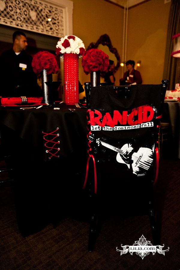 Rancid chair covers, corset style, Punk Rock Wedding inspiration, red and black wedding, spiked vases, red and black vases, rock and roll wedding inspo,ramones, sex pistols