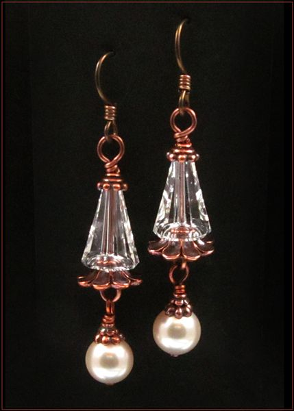 These simple and swanky Victorian style earrings feature crystal and pearl Swarovski Elements with copper-plated TierraCast bead caps and findings....