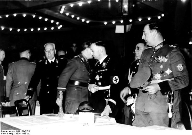 Heinrich Himmler and Berlin police chiefs Wolf Heinrich Graf von Helldorff and Kurt Daluege at a sporting event held in honour of Italian police leaders' visit to Berlin, Germany, 1936. Bundesarchiv, ID: Bild 121-0175.