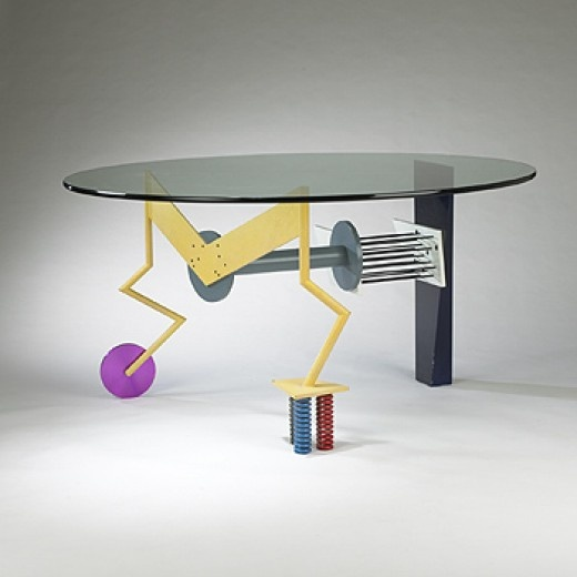 PETER SHIRE    dining table    Memphis  USA, c. 1988  enameled metal, powder coated steel, aluminum, glass  64 dia x 33.5 h inches