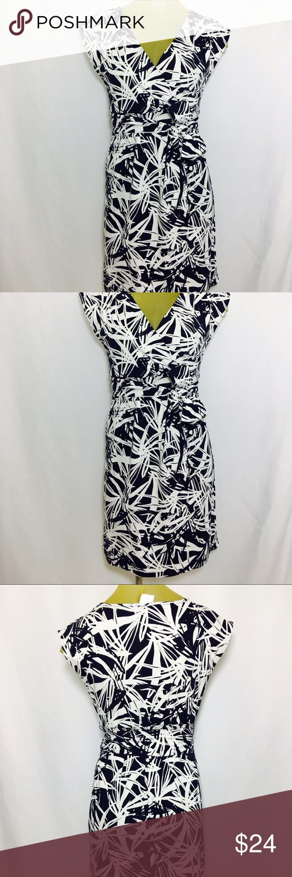 Ann Taylor Loft dress size Small new With Tags Ann Taylor Loft dress. Size Small. White with navy print. 95% cotton 5% spandex. 21 inches from left to right armpit. 36 inches from top of the shoulder to the bottom hem. Ann Taylor Loft Dresses Midi