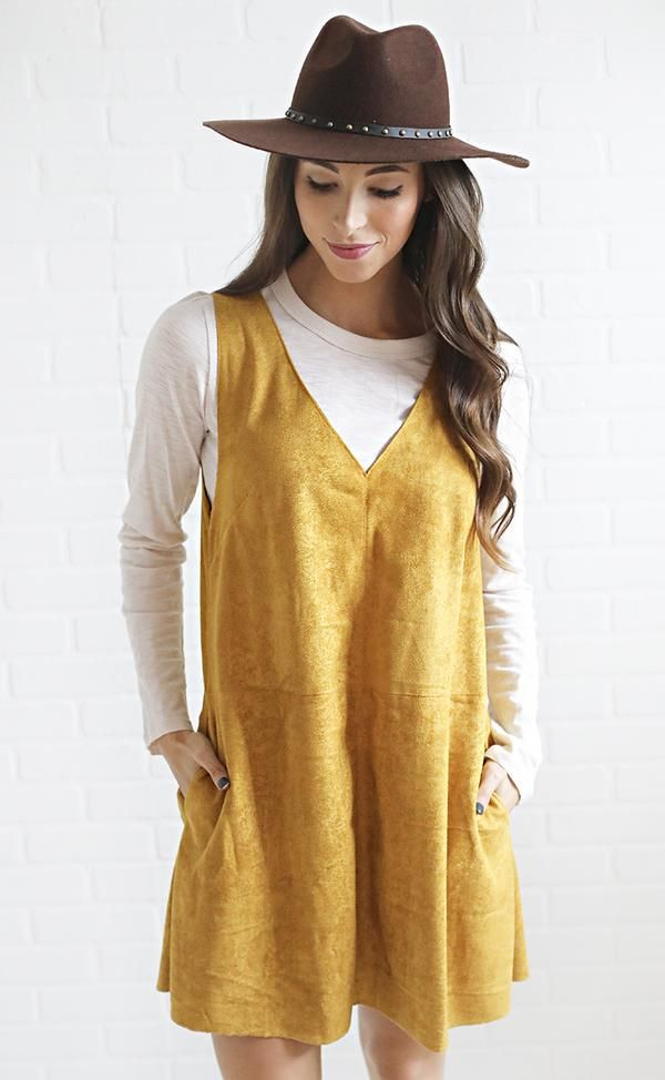 Make a subtle statement. This dress features fun mustard color and is made from a soft faux-suede fabric. Style it over a long sleeve tee and add booties + a ha