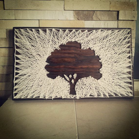 Taking vintage style string art & making it modern! This stunning statement piece is created from reclaimed wood, natural colored crochet string, &