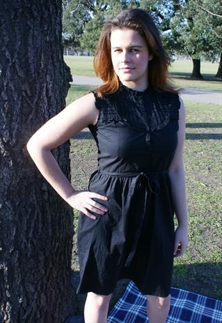 Black frill dress size 10-12 with tie belt detail.