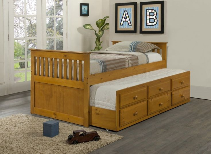 Maximize your space by adding this Mission Captain Kids Bed with 3 Underbed Storage Drawers Plus Trundle bed. The 100-percent solid pine construction and simple, but refined design make this trundle b