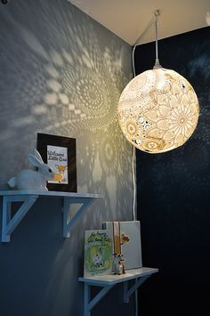 DIY doily lamp. Pretty. Never thought much of them when I saw pictures but this makes me want to make one quite badly!! Especially for a nursery...  The only thing that worries me is cleaning it!
