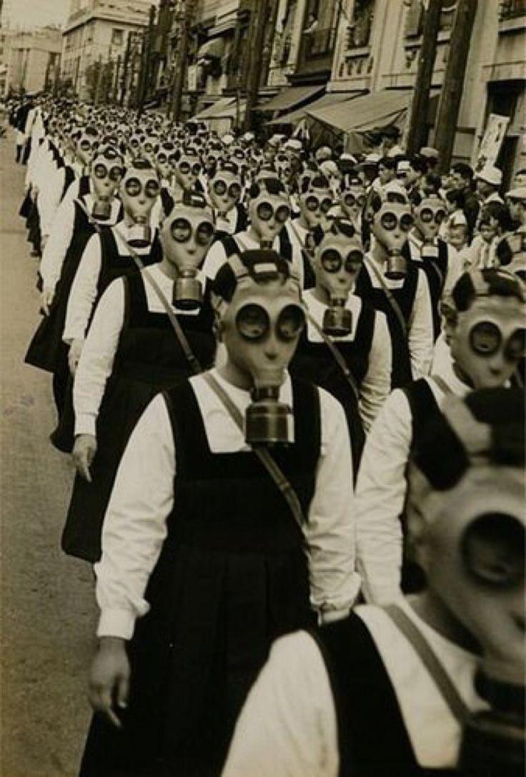 School girls in gas masks. WWII.