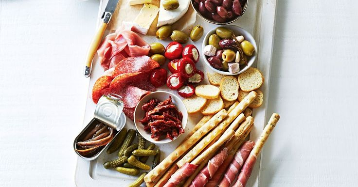 For easy entertaining serve up this delicious antipasto platter loaded with stuffed peppers, olives, creamy camembert and cured meats.