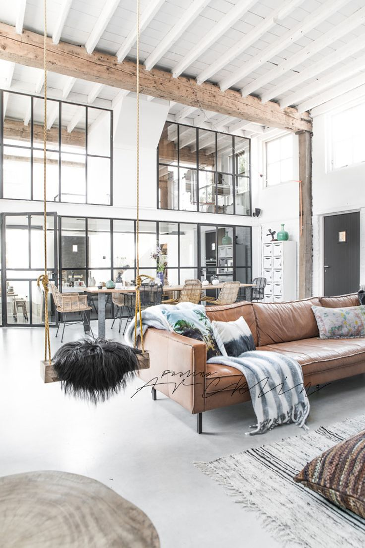 1049 best loft living images on pinterest architecture loft living room with industrial windows and caramel leather couch even a living room swing