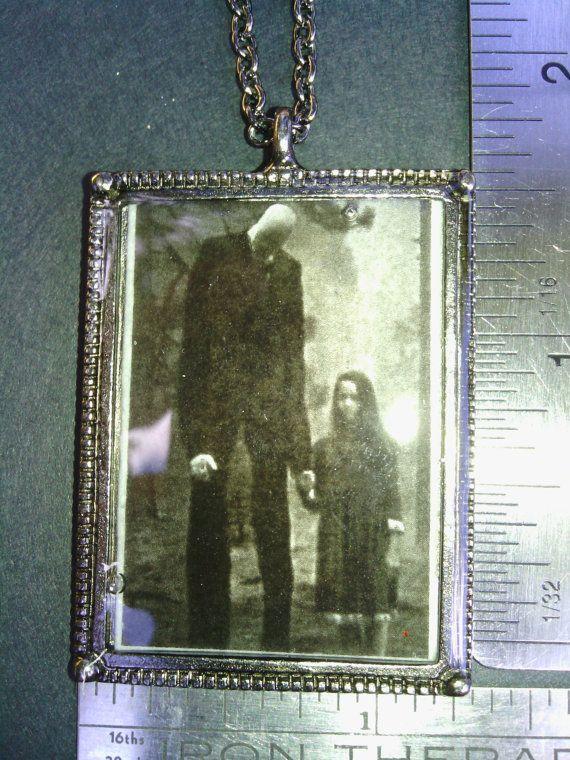 Slender man w/young girl/ creepy/dark/frightening