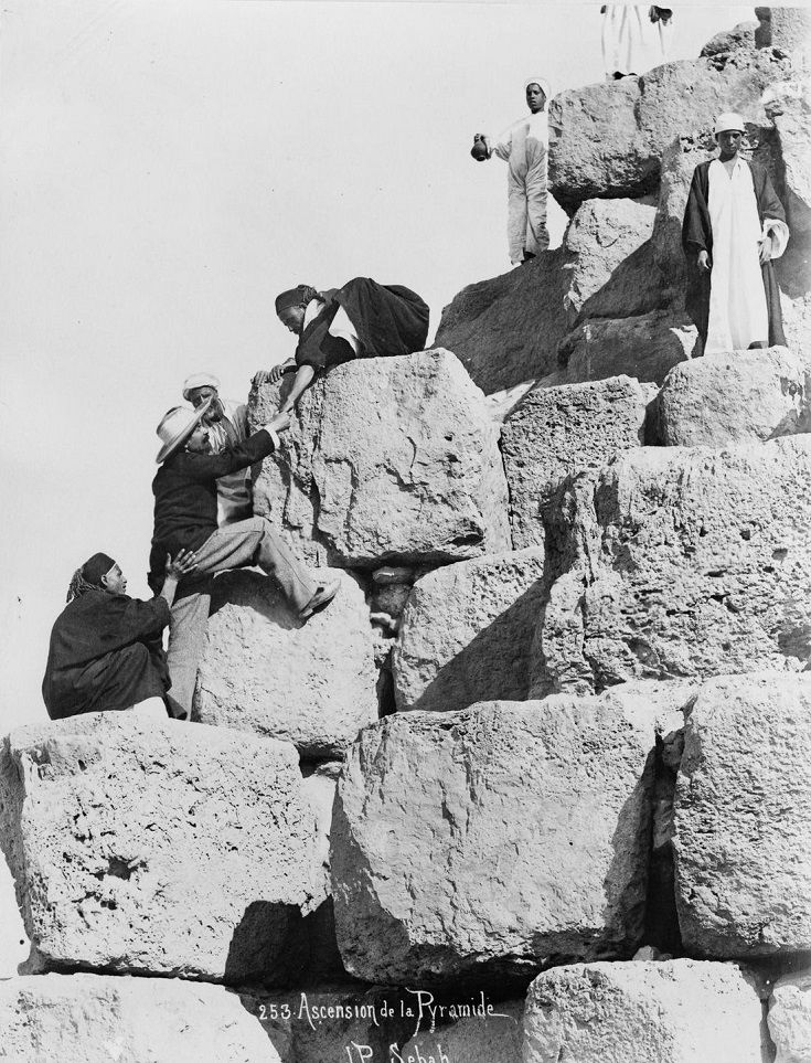 Photographs of the Pyramids of Giza taken at the height of colonialism show tourists climbing the massive structures and offer more insight into the evolution of tourism in Egypt.