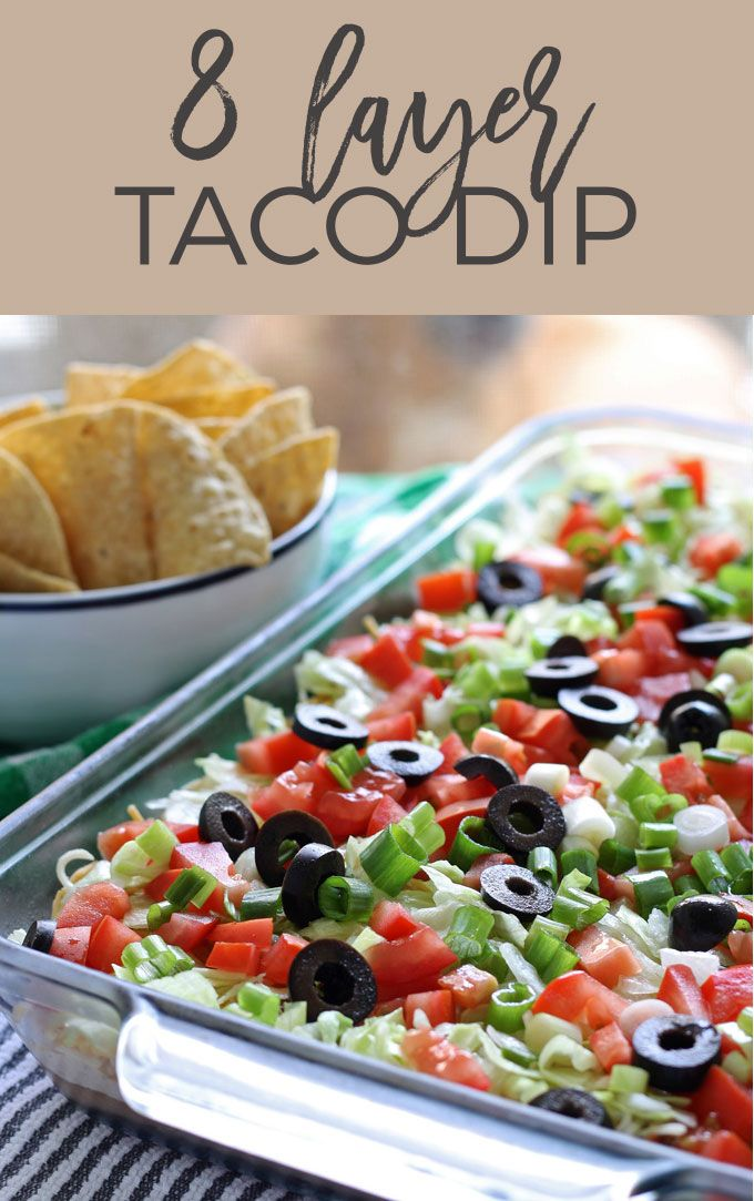 Go big with this 8 layer taco dip recipe - it is the perfect appetizer for large crowds. It's full of meat, cheese, veggies and more! | honeyandbirch.com | game day | tailgating | football | party | basketball | super bowl