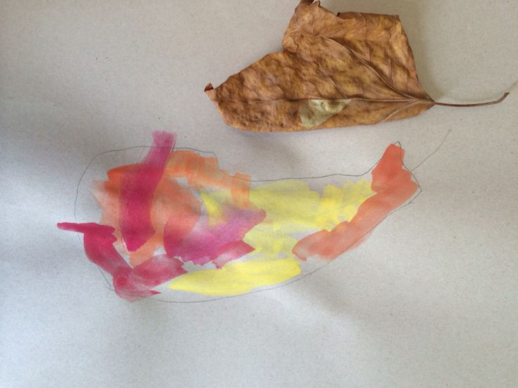 Observing autumn leaves with toddlers