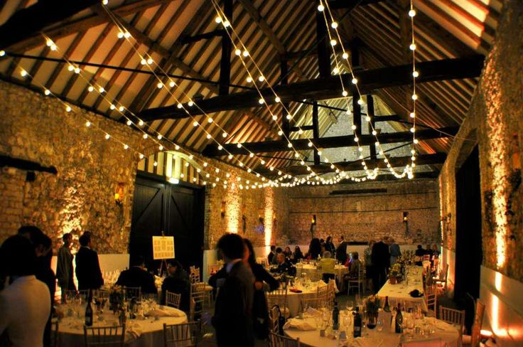 Festoon lighting canopy as an alternative to fairy lights, Monks' Barn Hurley. Wedding lighting by Oakwood Events Ltd.
