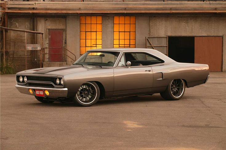 "1970 Plymouth Road Runner named ""The Hammer"". The Hammer was custom built by the people at Pure Vision Design with an all aluminum 526 HEMI big block, was featured on RIDES, in Hot Rod magazine, at SEMA and of course in the movie Fast & Furious 3 and 4. It is for sure a ground-pounder."