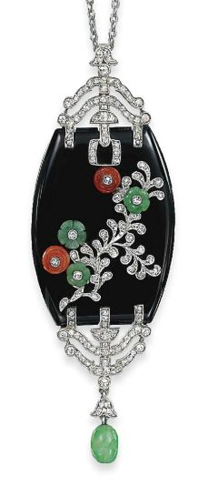AN ART DECO ONYX AND MULTI-GEM PENDANT   The tonneau-shaped onyx plaque mounted with carved jade and coral flowerheads, each studded with a circular-cut diamond collet to the diamond detail of foliate design and similarly-set openwork terminals, to the suspended jade bead, circa 1925, 6.7cm long
