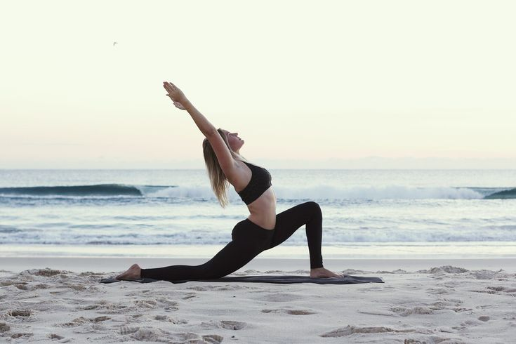 Miann Scanlan sunrise beach yoga. Photograph by @In Search Of This
