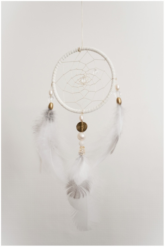 Dreamcatcher made with grouse feathers from the north of Norway, quartz, pearl and brass. www.malinpettersen.com
