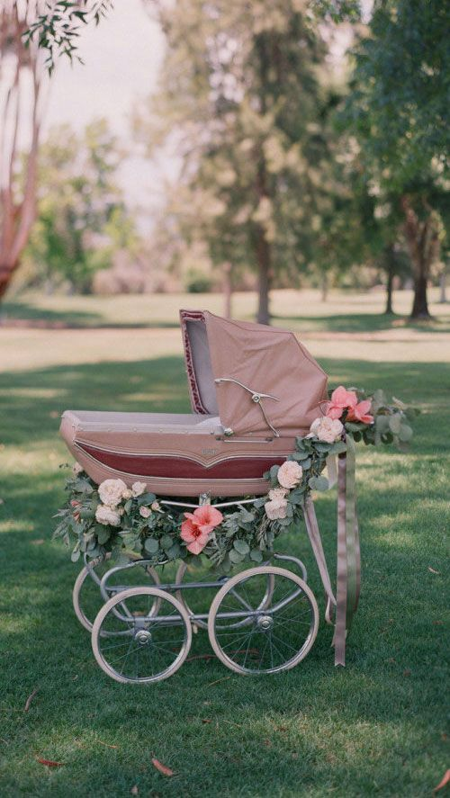 Vintage pram adorned with beautiful wreath and flowers!!