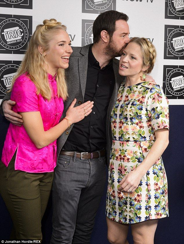 So close: Danny Dyer poses up a storm with his on-screen wife Kellie Bright and on-screen ...
