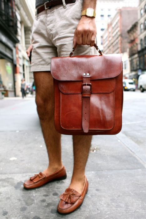 A classic, preppy look! Mid thigh length khaki shorts and brown tasseled loafers matched to a great leather bag.