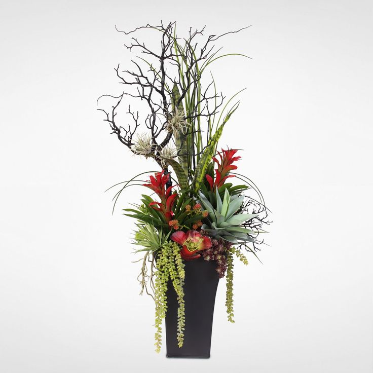 Bring a colorful and quirky look to your foyer with this silk floral arrangement. Housed in a metal container, the arrangement includes several types of plants and flowers that create a striking visua