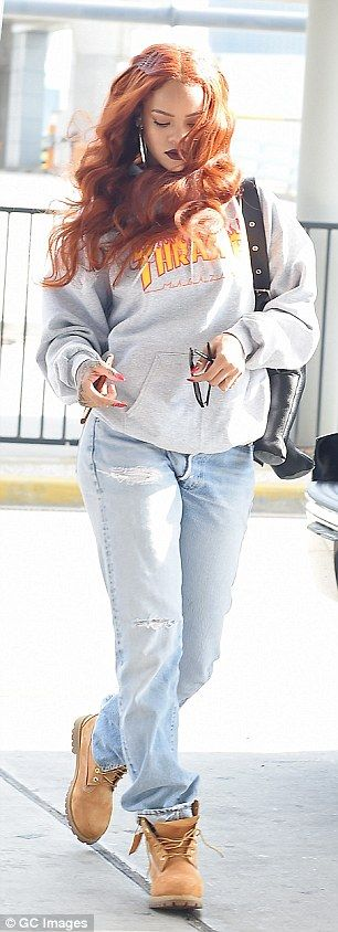 Comfy: Rihanna teamed baggy jeans and Timberland boots with a grey sweatshirt for her low-...
