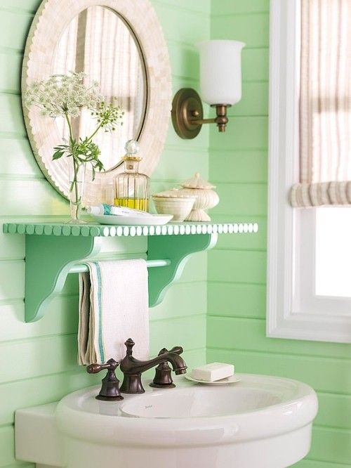 Love hand towel rack above sink: Mint green in the bathroom? Why not? Excellent feng shui for an East or Southeast facing bathrooms. Looks great with antique brass and panelled walls.