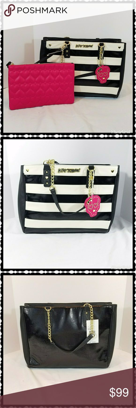 "Betsey Johnson striped shoulder bag / purse /tote This black and white tote bag is absolutely stunning. Also included is a pink clutch that comes with a removable strap. There is an adorable pink skull mirror keychain that is removable. The bag is fully lined in the iconic floral Betsey Johnson print. There are three pockets on the inside. Gold hardware, including the Betsey Johnson plaque on the front. Approximate measurements are 16"" x 12"" x 6"" with a 9.5"" shoulder drop. There are so many…"