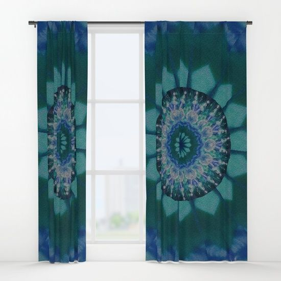 Coloured Gravel in Teal Curtains by Terrella.  A kaleidoscopic pattern with a gravel texture appearance of a sun with a circle of bulb florets and another sun in the center with lines radiating out to a marbled edge.  This is the teal version.