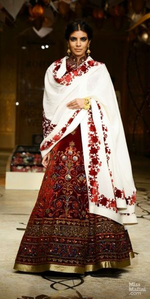 Model walks the ramp in red lehenga with cream embroidered dupatta for Rohit Bal at Indian Bridal Week 2013