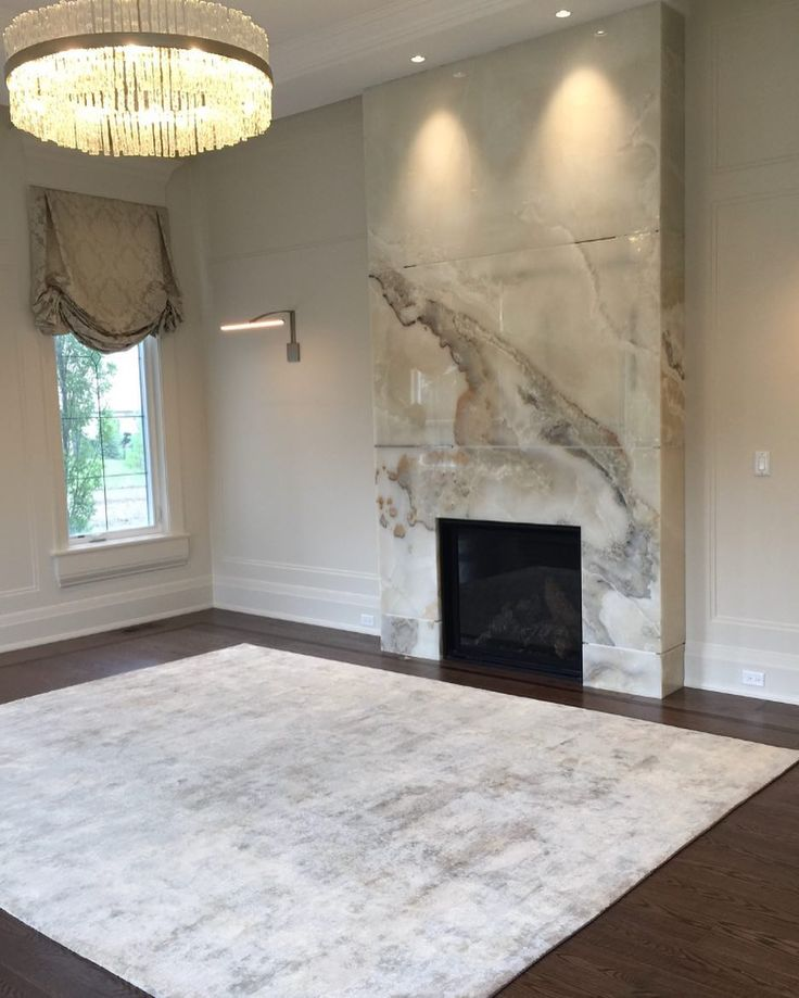 One of our current designs in progress.  We Love this Onyx Fireplace and how it dialogues so beautifully with this stunning silk & wool hand woven area carpet from W Studio.  Next - the fireplace to be fitted with satin brass reveal strips and some  custom designed bespoke furniture.  @arielmullerdesigns  #CustomHome #interior #InteriorDesign #Decor #Luxe #Lux #Lifestyle #Luxury #luxurylifestyle Lifestyle #Fireplace #Onyx #OnyxFireplace  #Custom #Carpet #Silk #Wool #HandWoven…