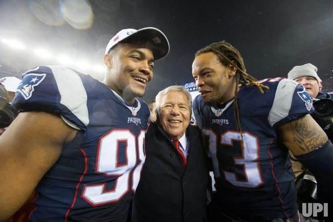 New England Patriots owner Robert Kraft (C) celebrates with defensive lineman Trey Flowers (98) and Jabaal Sheard (93) after the Patriots…