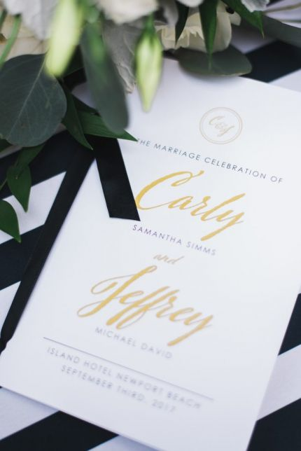 Black, white, and gold wedding program with monogram.  Stationery designed by Agape Planning.