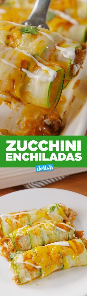 1 tbsp. extra-virgin olive oil 1 large onion, chopped kosher salt 2 cloves garlic, minced 2 tsp. ground cumin 2 tsp. chili powder 3 c. Shredded chicken 1 1/3 c. red enchilada sauce, divided 4 large zucchini, halved lengthwise 1 c. Shredded Monterey Jack 1 c. shredded Cheddar Sour cream, for drizzling Fresh cilantro leaves, for garnish
