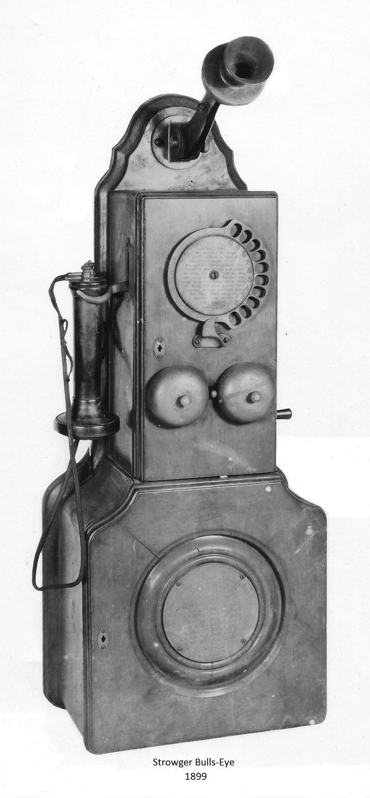 "Strowger Automatic Telephone Exchange. Known as a ""Bullseye Strowger"" ca. 1899-1900. Notice the celluloid patent disc in the center of the bottom battery box."