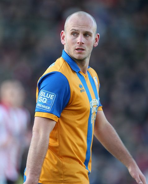 Adam Murray Photos Photos - Adam Murray of Mansfield Town in action during the FA Cup with Budweiser Second Round match at Sincil Bank Stadium on December 1, 2012 in Lincoln, England. - Lincoln City v Mansfield Town - FA Cup Second Round