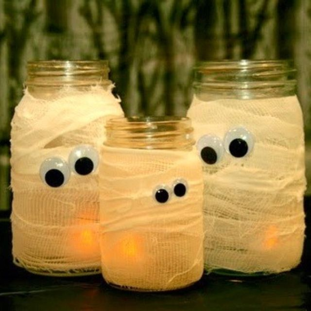 so cute and simple... gauze wrapped glasses and googly eyes and add one of those battery candles