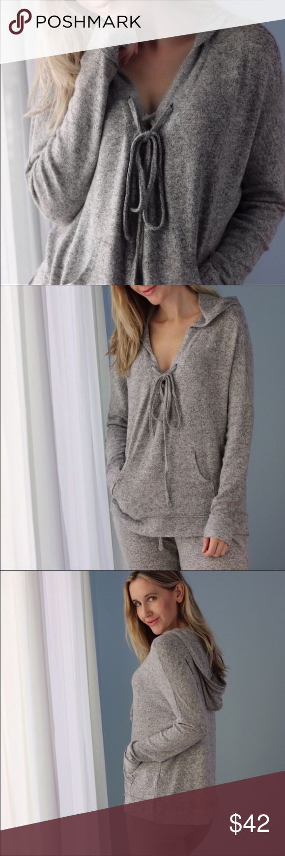 """Soft lace up """"cashmere"""" hoodie Beautiful heather grey cashmere-like sweater hoodie with a chic lace up neck line and kangaroo pocket detail! I'm reposhing from @11thstreet this lovely piece because it was too small for me :( my loss is your gain! Sweaters V-Necks"""