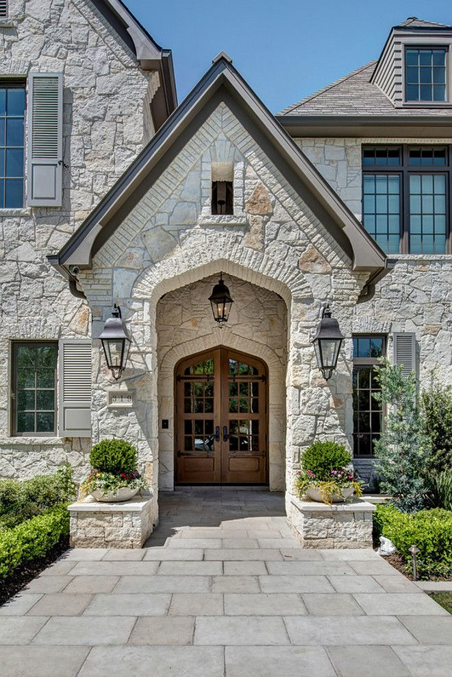 """Exterior stone. The exterior stone is a full 4"""" limestone quarried in Oklahoma, sold locally by Alamo Stone. Their in-house name is Alamo White Ledgestone. #exteriorstone #exterior #stone Allan Edwards Builder Incstone-exterior-with-wood-front-door"""