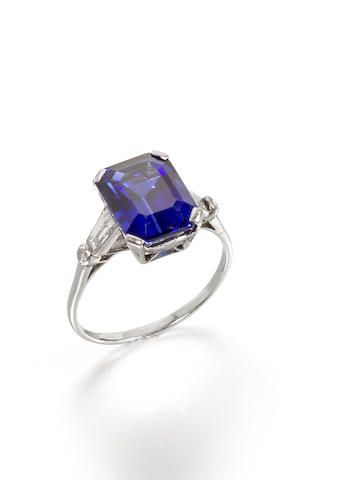 A sapphire and diamond ring, by Boucheron The rectangular step-cut sapphire…