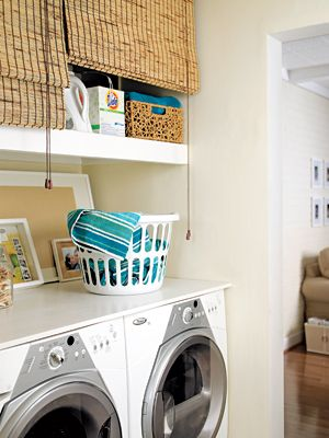 inexpensive alternative to cabinet storage--bamboo blinds covering shelves.  interesting idea.Messy Shelves, Romans Shades, Hiding Messy, Living Room Curtains, Laundry Rooms, Room Clutter, Cleaning Supplies, Bamboo Blinds, Hiding Laundry