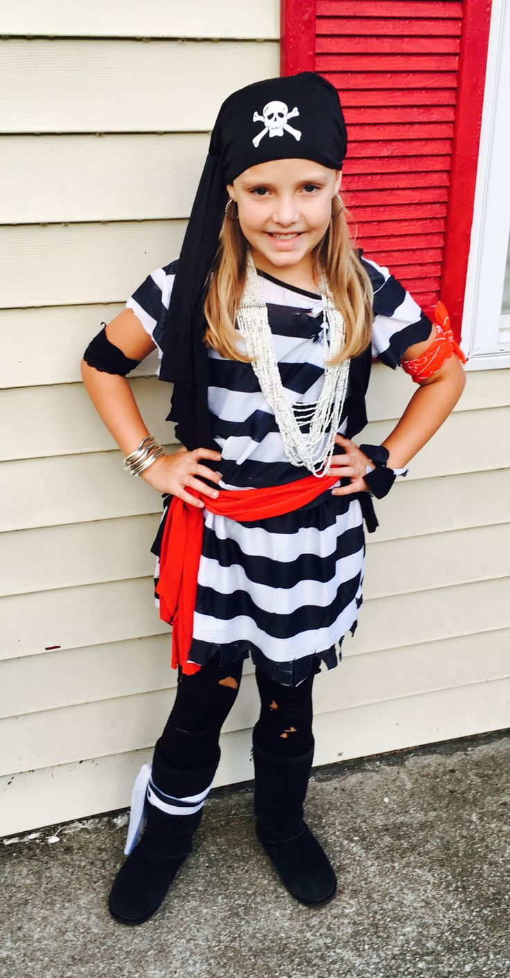 "Easy girl's pirate costume made from cheap adult size ""prisoner"" costume and an old t-shirt."