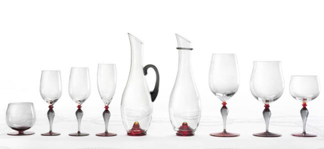 Designed by Stefano Marcato for Nason Moretti, Divini is a glasses service made of Murano's glass, finely worked. Divini is a glasses service by the elegant design. It's characterized by its classic charm and by the perfect combination created between crystal, gray and steel colors that will give character and style to your table.