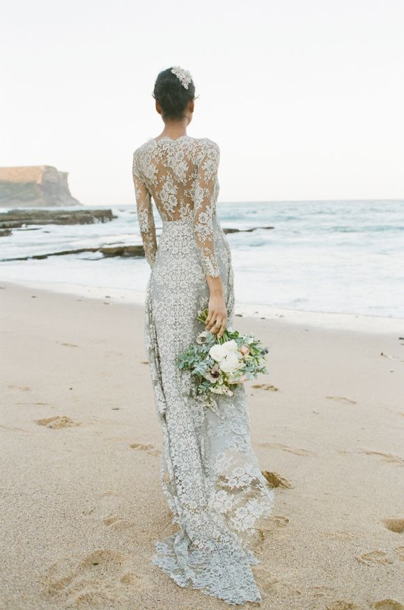 Pale blue wedding dress on beach