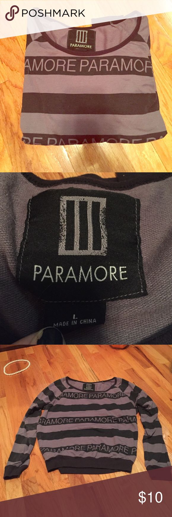 Hot Topic Paramore Pull over Sweater Size Large Hey guys! Here I have for a Paramore sweater from Hot Topic. It's been sitting in my closet for ages. It's really a great sweater. A very light material, good for Fall of Spring! It's a size large and fits accordingly! Hot Topic Sweaters Crew & Scoop Necks