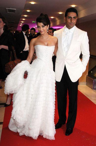 Aishwarya Rai  w/ her husband Abhishek Bachchan- I dont always like white jackets on men but Abhishek rocks this outfit.